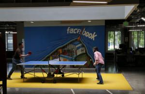 Facebook employees take a ping pong breakThursday morning, May 8, 2014, at the company's campus in Menlo Park, Calif. (Karl Mondon/Bay Area News Group)